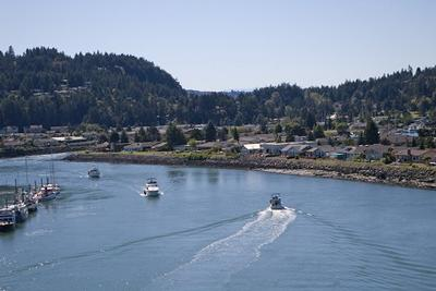 Boat traffic in the Swinomish Channel, headed toward Shelter Bay.