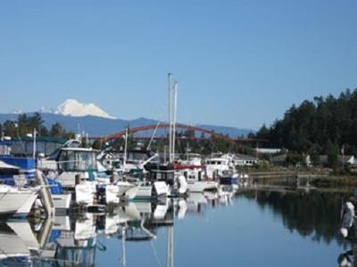 Shelter Bay marina with Mount Baker and the Rainbow Bridge in the background.